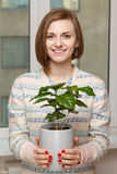 Girl with houseplant Stock Photo