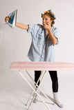 Girl houseworking. Girl doing housework with hair curlers Stock Photography