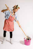 Girl houseworking. Girl doing housework with hair curlers Royalty Free Stock Image