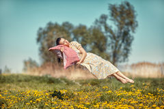 Girl hovers and sleeps. Royalty Free Stock Photography