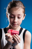 Girl hpoing in a great gift Royalty Free Stock Photography