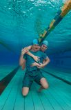 Girl hug boyfriend underwater Royalty Free Stock Photography