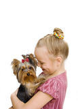 Girl hug a little Yorkshire Terrier puppy Stock Photo