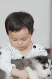 Girl hug puppy. Chinese girl play with a puppy Stock Photos