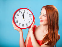 Girl with huge clock Stock Images