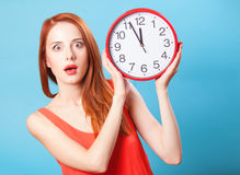 Girl with huge clock Royalty Free Stock Photography
