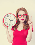 Girl with huge clock Royalty Free Stock Image