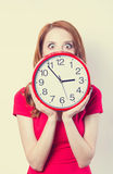 Girl with huge clock Royalty Free Stock Images
