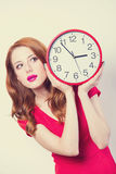 Girl with huge clock Stock Photo