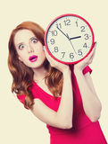 Girl with huge clock Stock Photography