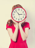 Girl with huge clock Royalty Free Stock Photos