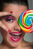 Girl with huge lollipop Stock Photos