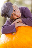 Girl with huge pumpkin autumn Stock Photography
