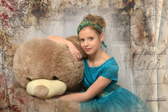 Girl with huge teddybear Royalty Free Stock Photography