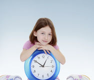 Girl hugged clock. Stock Image