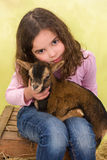 Girl hugging baby goat Stock Photography