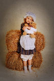 Girl hugging a bear near the hay. Girl hugging a bear near the hay Stock Photo