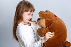 Girl hugging bear. A portrait of a young pretty girl smiling and hugging her teddy bear Stock Image