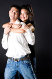 Girl hugging from behind the guy. Loving young couple smiling with the girl hugging from behind the guy Stock Photo