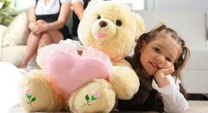 girl is hugging big bear Royalty Free Stock Photos
