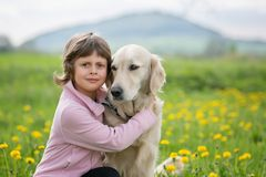 Girl hugging a big dog in an outdoor setting Royalty Free Stock Photo