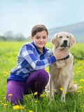 Girl hugging a big dog in an outdoor setting Royalty Free Stock Photos