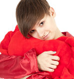 Girl hugging big red heart pillow Royalty Free Stock Images