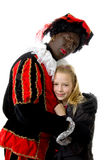 Girl is hugging black pete Royalty Free Stock Photos