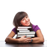 Girl hugging books Royalty Free Stock Photo