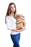 Girl hugging a books pile Royalty Free Stock Image