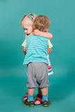 Girl hugging a boy Stock Image