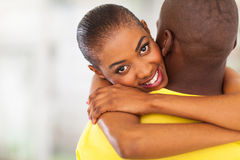 Girl hugging boyfriend Stock Photos