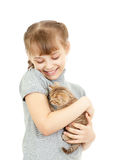 Girl hugging with British kitten Royalty Free Stock Images