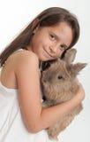Girl hugging a bunny Stock Photography