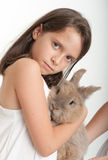 Girl hugging a bunny Stock Images