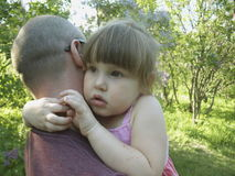 Girl hugging dad royalty free stock images