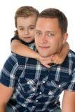 Girl hugging dad's neck Stock Photo
