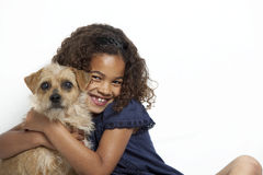 Girl hugging dog Royalty Free Stock Images
