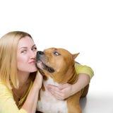 Girl hugging dog Stock Photos
