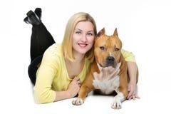 Girl hugging dog Stock Photography
