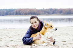 Girl hugging dog outdoors Stock Image
