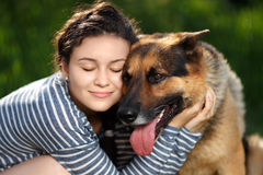 Girl hugging dog Royalty Free Stock Photo