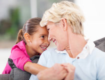 Girl hugging grandma. Cute little girl hugging grandma at home Royalty Free Stock Photography