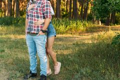 The girl is hugging the guy from behind. resentment, quarrel. ask for forgiveness. Ask for forgiveness. the girl is hugging the guy from behind. resentment royalty free stock photos
