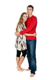 Girl hugging a guy in a red dress in the studio Royalty Free Stock Images