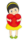 Girl hugging a heart Royalty Free Stock Images