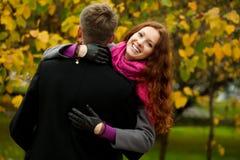 Girl hugging her boyfriend Stock Image