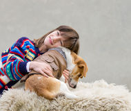 Girl hugging her dog Stock Photography