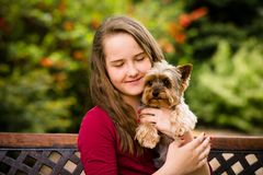 Girl hugging with her dog Stock Images