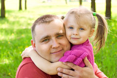 Girl hugging her father Stock Image